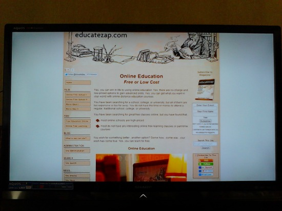 Photo of HDTV with screen cast using digital media streaming adapter.