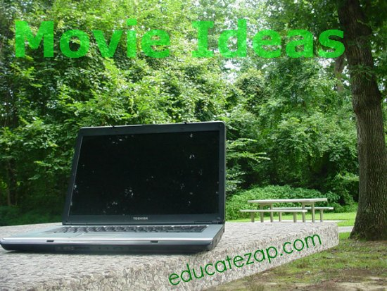 Creating film ideas with laptop in a park.